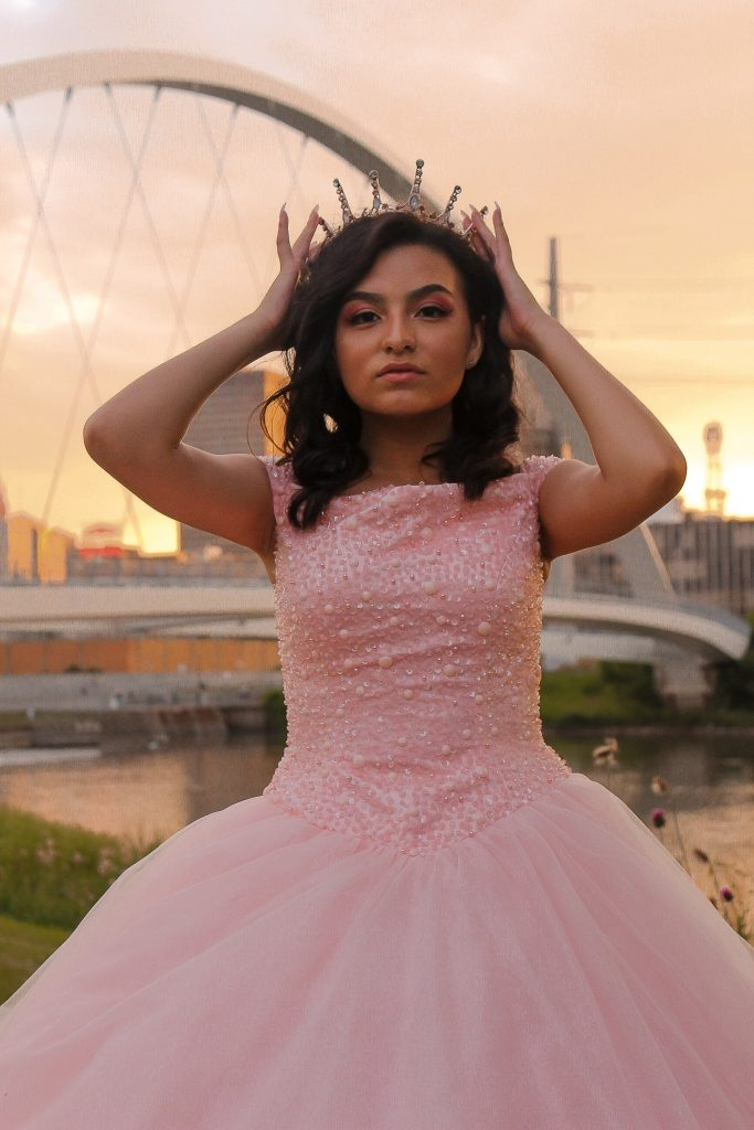 A girl in a pink princess dress