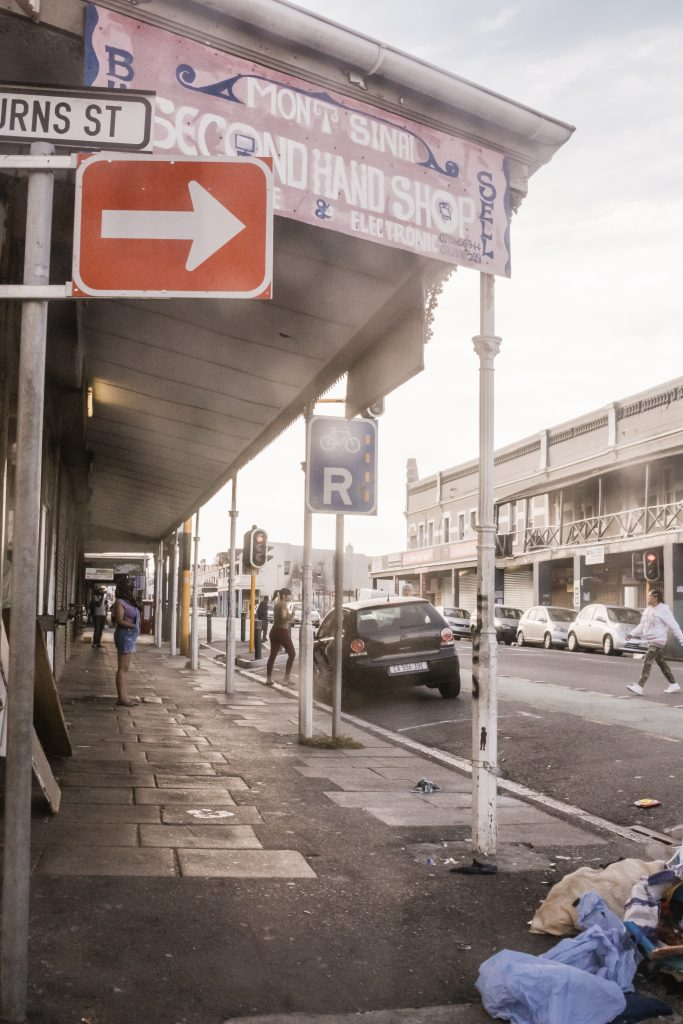 a rubbish filled street in a post talkign about social signalling